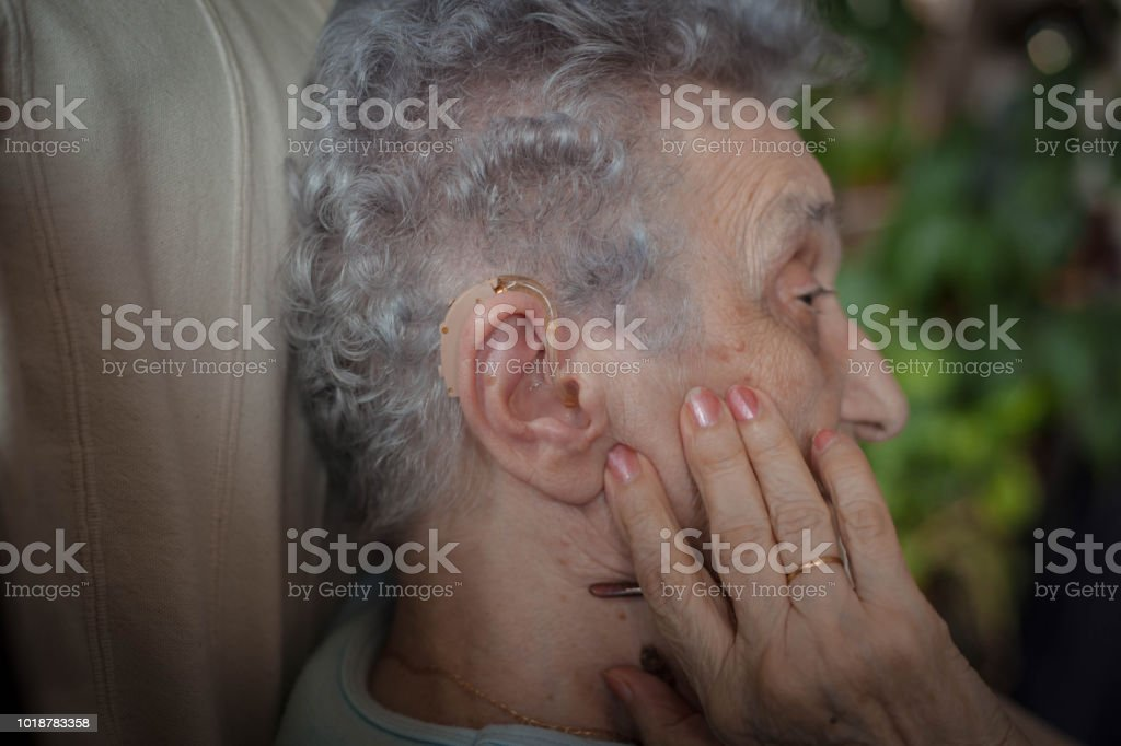 This will help me to hear better. stock photo