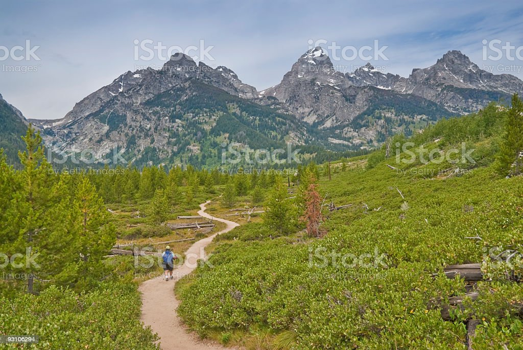 Mature Woman Hiking in the Tetons stock photo