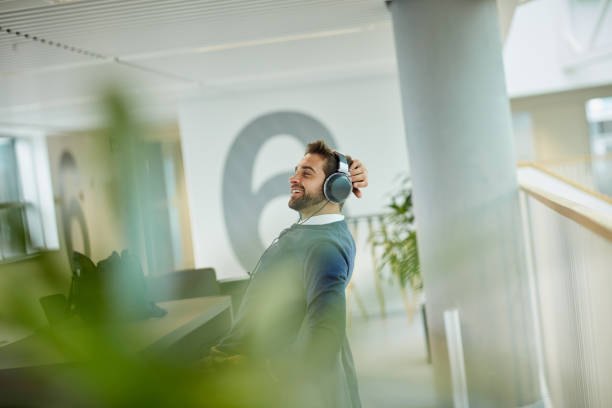 This work playlist really keeps me motivated stock photo