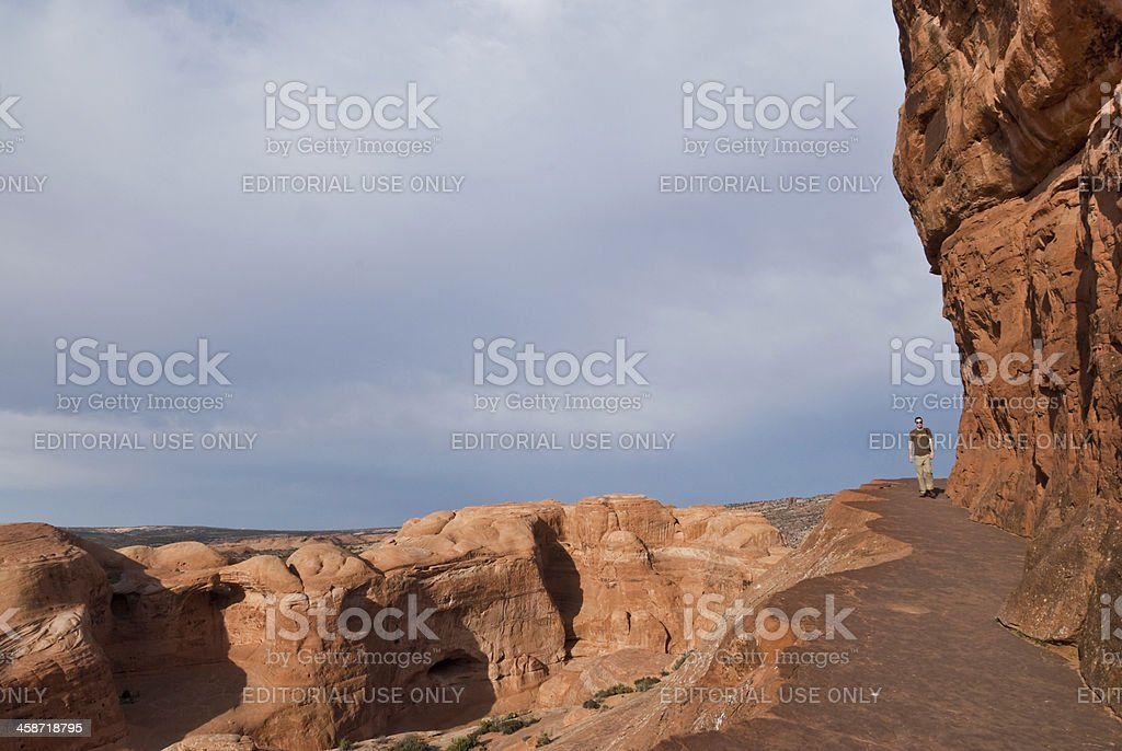 Hiking the Delicate Arch Ledge Trail Arches National Park, Utah, USA - May 16, 2012: This young man is hiking on the Delicate Arch Ledge Trail in the evening. Active Lifestyle Stock Photo