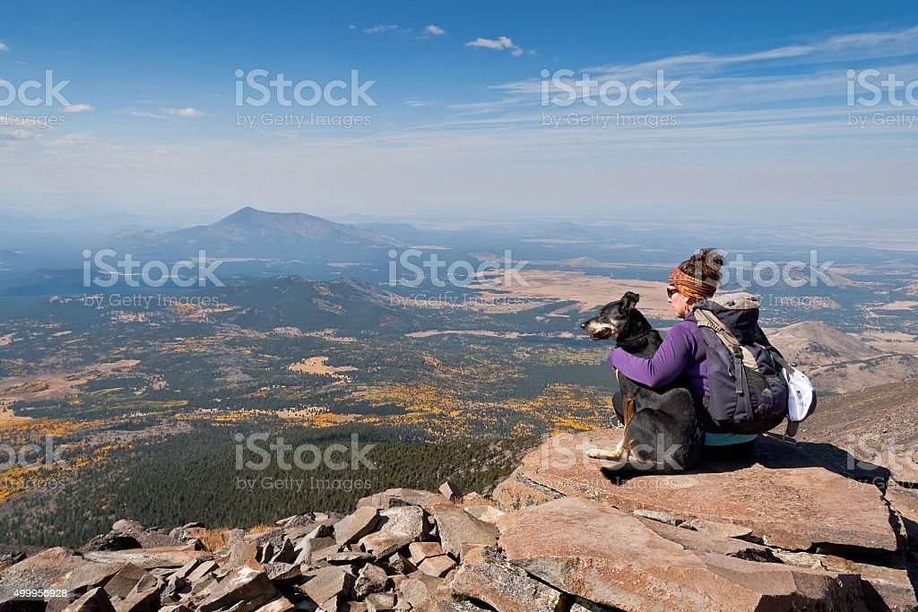 Hiker and Dog on Humphreys Peak stock photo