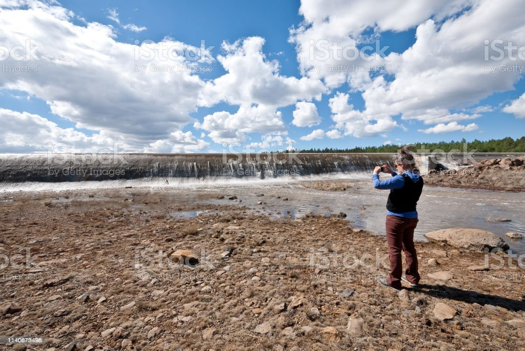 Taking a Picture of the Spring Overflow at Lake Mary Dam stock photo