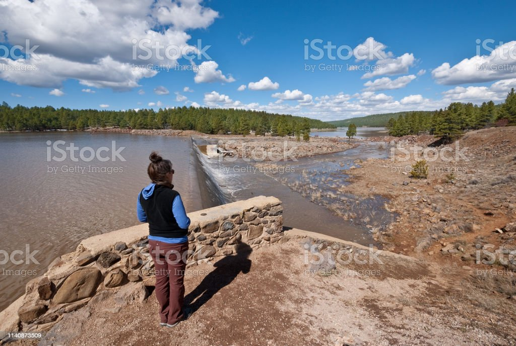 Watching the Spring Overflow at Lake Mary Dam stock photo