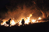 December 11, 2017 - Fire crews, using controlled burns, create a barrier in the foothills of Carpinteria, California, in the hopes of containing the Thomas fire in Southern California.