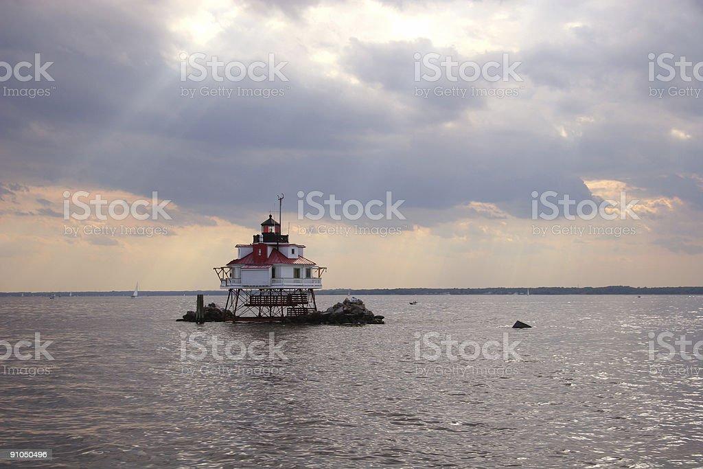 Thomas Point lighthouse under a dramatic sky royalty-free stock photo