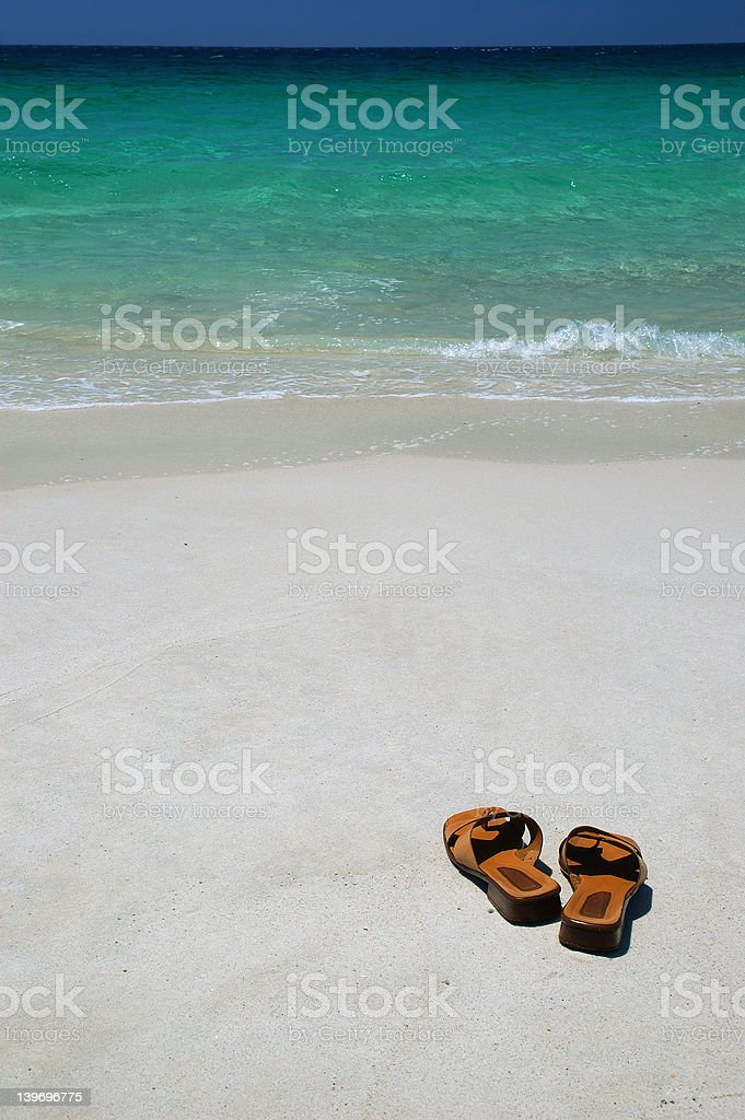 Thongs on a Beach royalty-free stock photo