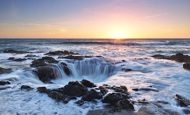 Thor's Well sunset, Cape Perpetua, Oregon stock photo