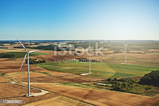 High angle shot of wind turbines on an open landscape in the french countryside during the day