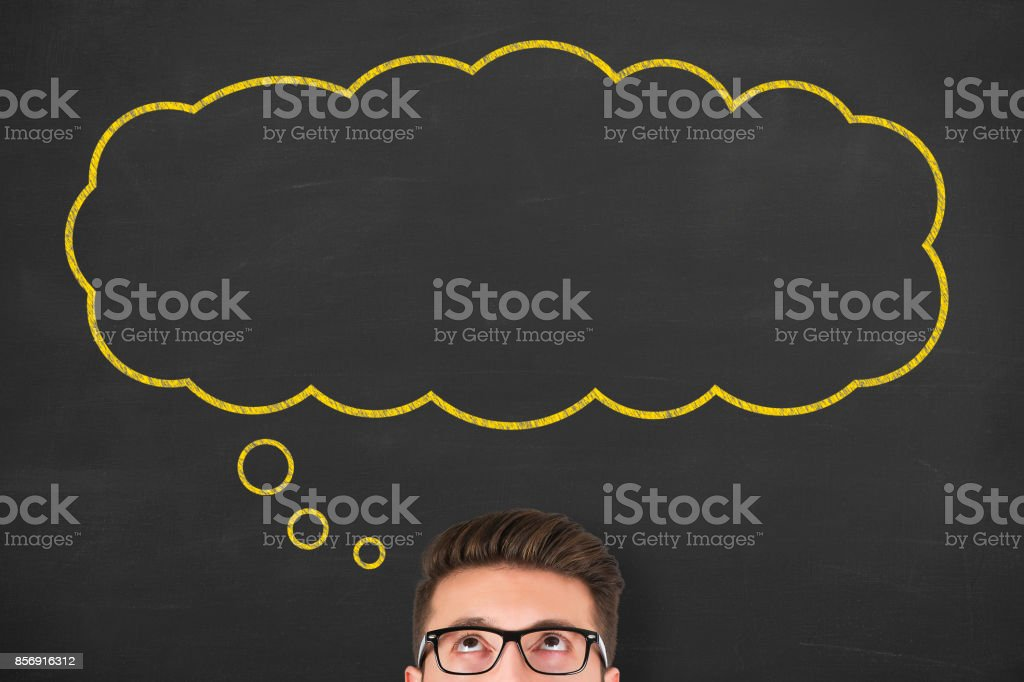 Thought bubble drawn over human head on chalkboard stock photo