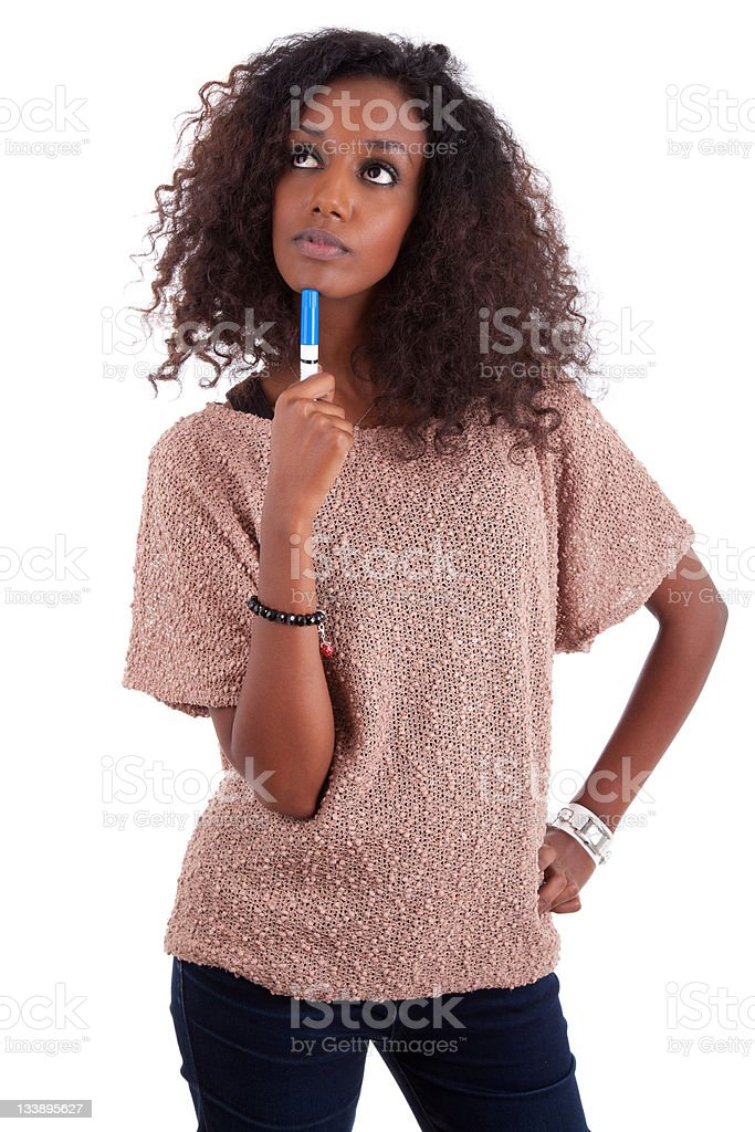 Thoughtful African American woman looking up royalty-free stock photo