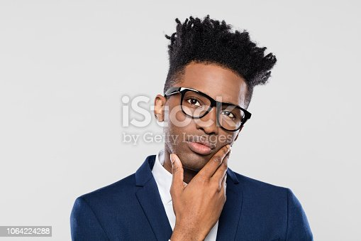 611876426 istock photo Thoughtful afro american businessman 1064224288