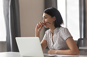 istock Thoughtful anxious asian business woman looking away thinking solving problem 1185049571