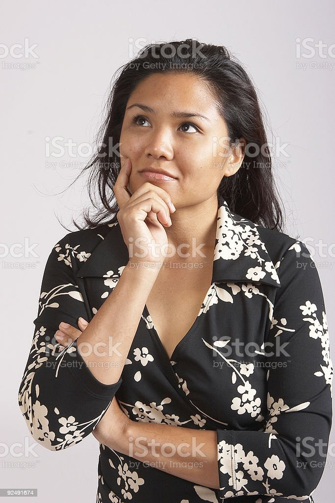 Thoughtful Asian woman royalty-free stock photo