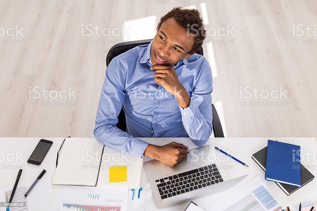 Thoughtful black guy in office royaltyfri bildbanksbilder