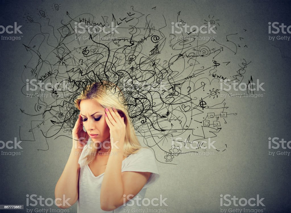 Thoughtful blonde woman with a mess in her head stock photo