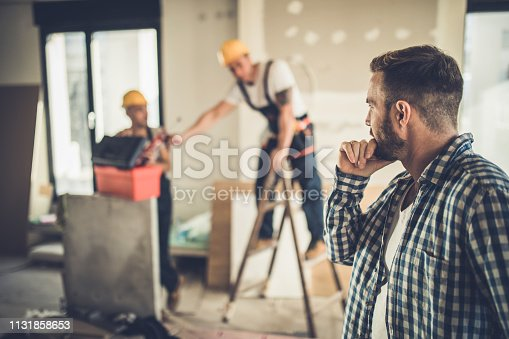 istock Thoughtful building contractor at construction site. 1131858653
