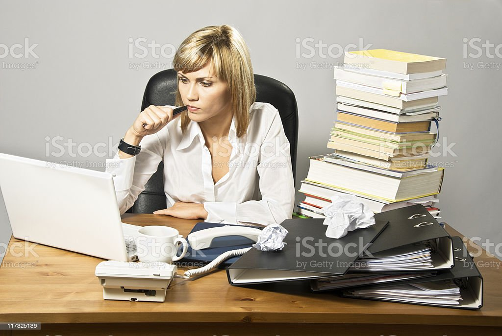 Thoughtful Business Lady at Desk royalty-free stock photo