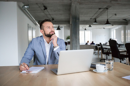 Thoughtful Businessman At Work In Office Stock Photo - Download Image Now