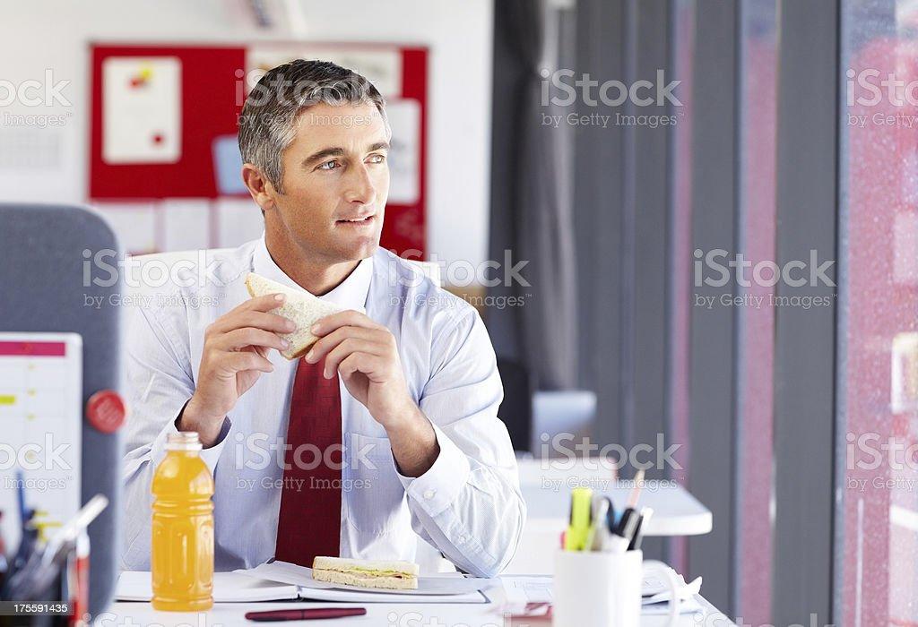 Thoughtful Businessman Having Sandwich royalty-free stock photo
