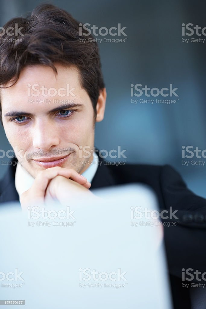 Thoughtful businessman in front of a laptop royalty-free stock photo