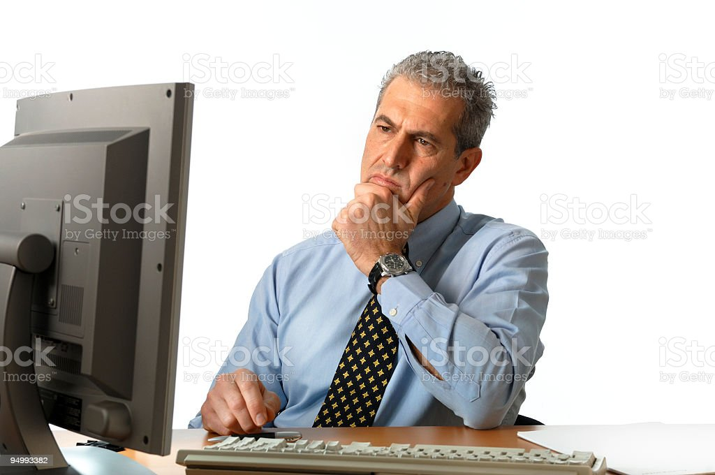 Thoughtful businessman in front of the monitor, on white background royalty-free stock photo