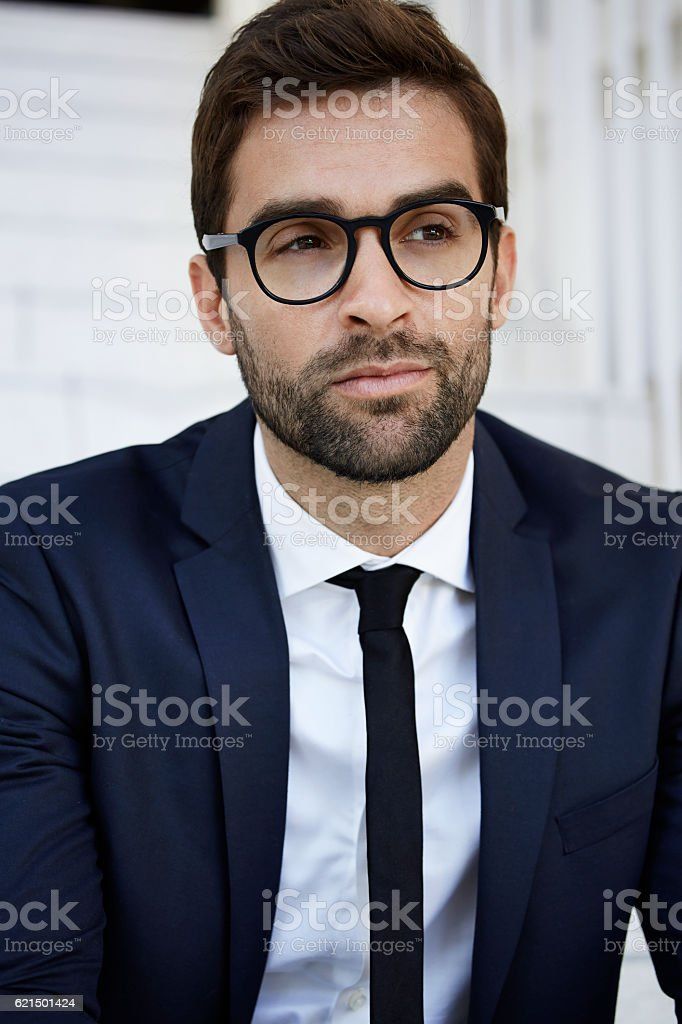 Thoughtful businessman in glasses, looking away foto stock royalty-free