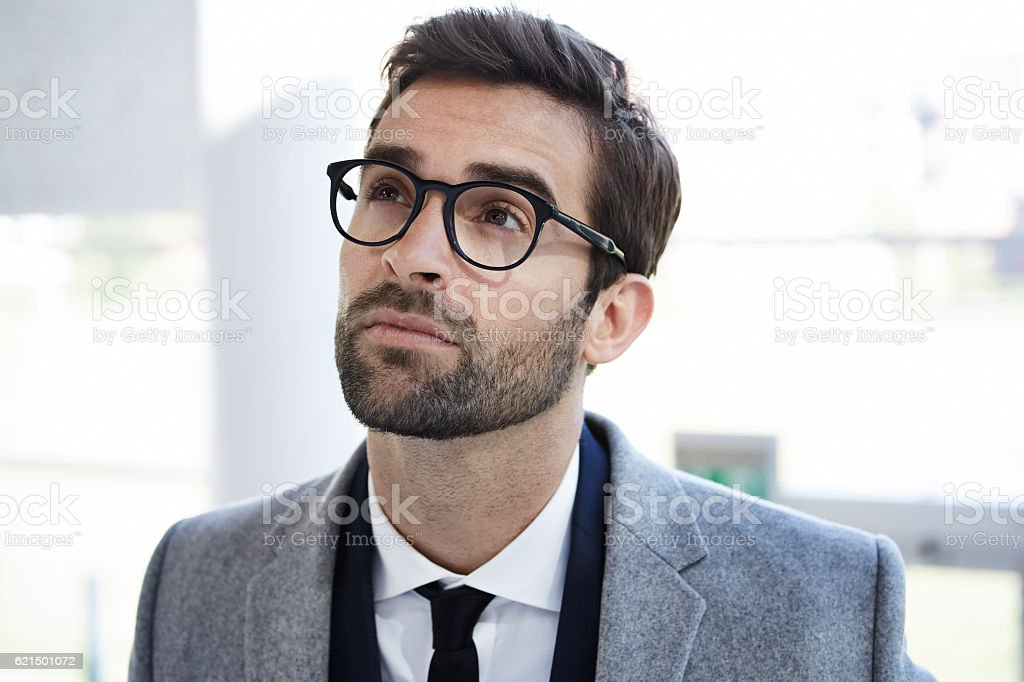 Thoughtful businessman in glasses, looking up Lizenzfreies stock-foto
