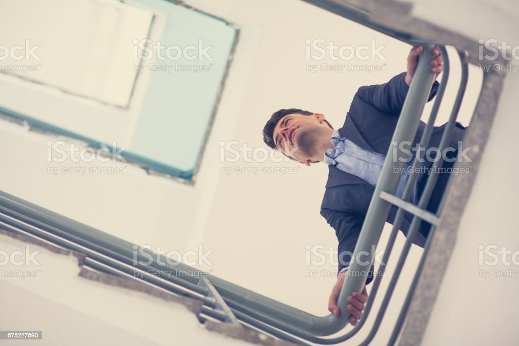 Thoughtful businessman leaning on stairs _tone royalty-free stock photo