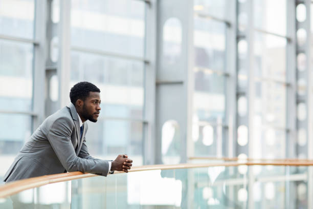 Thoughtful businessman Young employer thinking of forthcoming meeting with business partner introspection stock pictures, royalty-free photos & images
