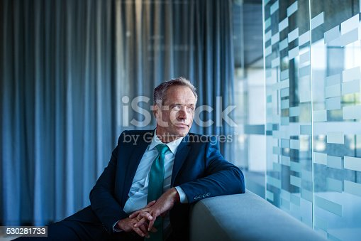 istock Thoughtful businessman sitting in office lobby 530281733