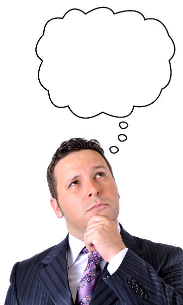 Thoughtful Businessman With Blank Thought Bubble stock photo