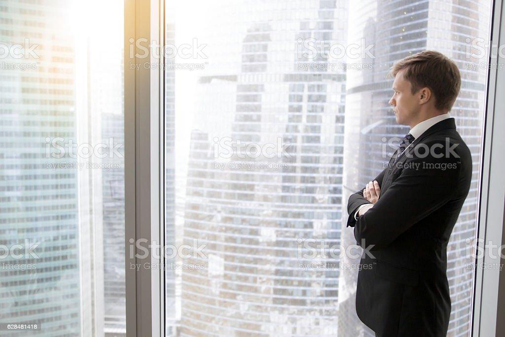 Thoughtful confident businessman stock photo