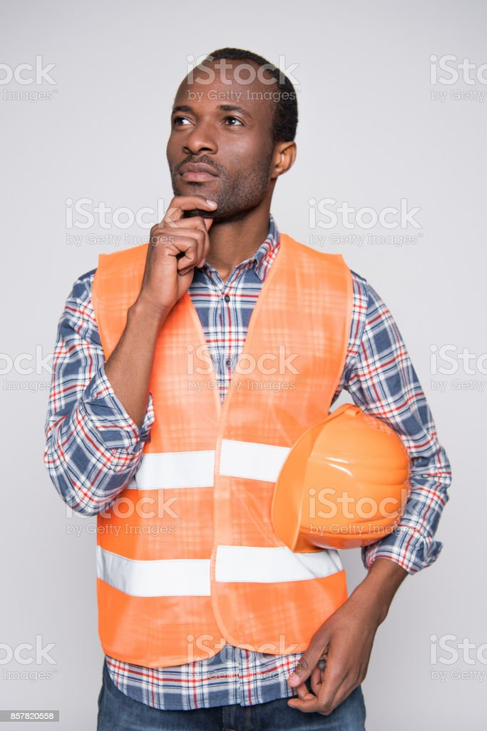 thoughtful construction worker stock photo