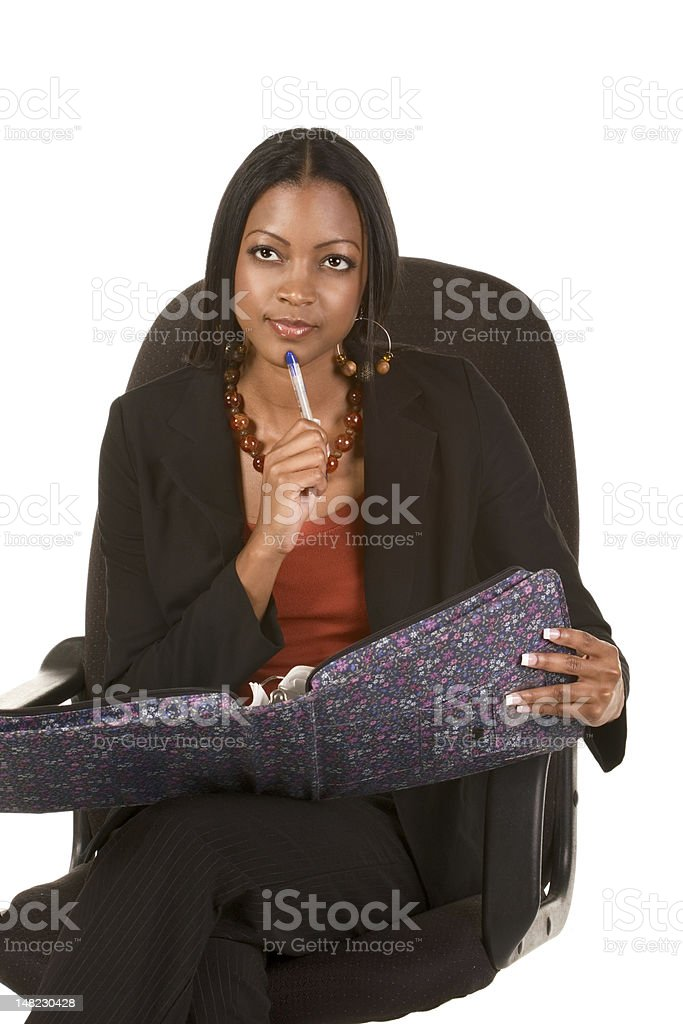 Thoughtful ethnic adult student with folder and pen royalty-free stock photo