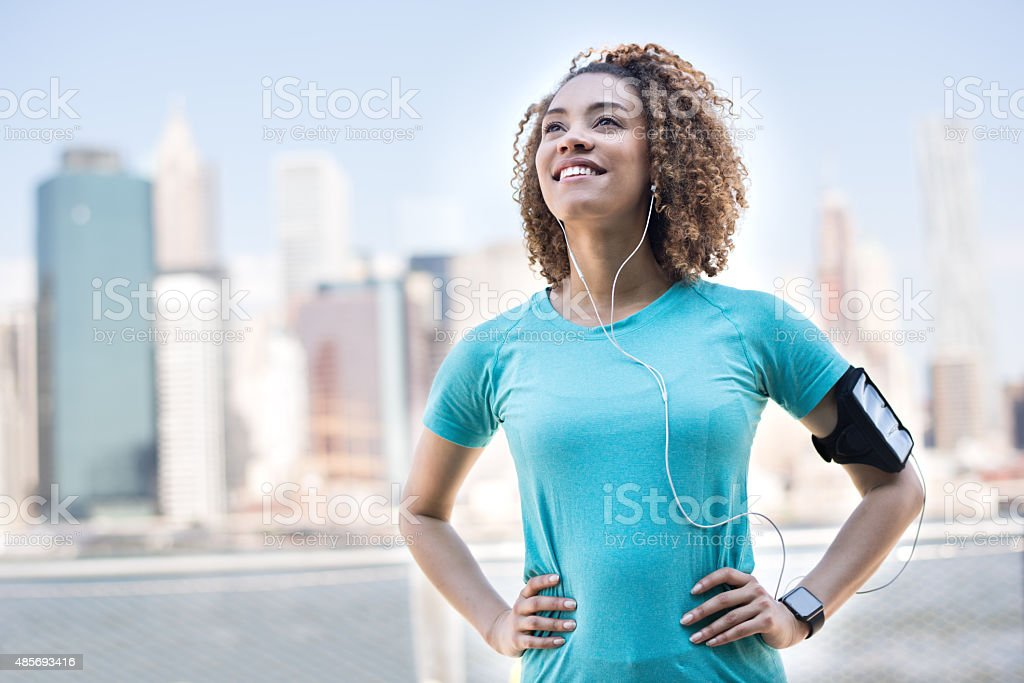Thoughtful female runner outdoors stock photo