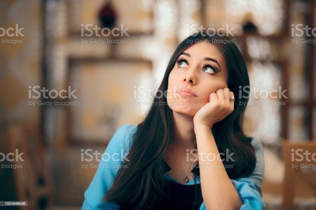 Thoughtful Girl Feeling Bored and Apathetic stock photo