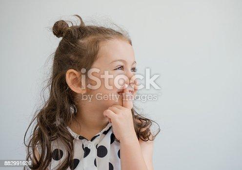 istock Thoughtful girl 882991626