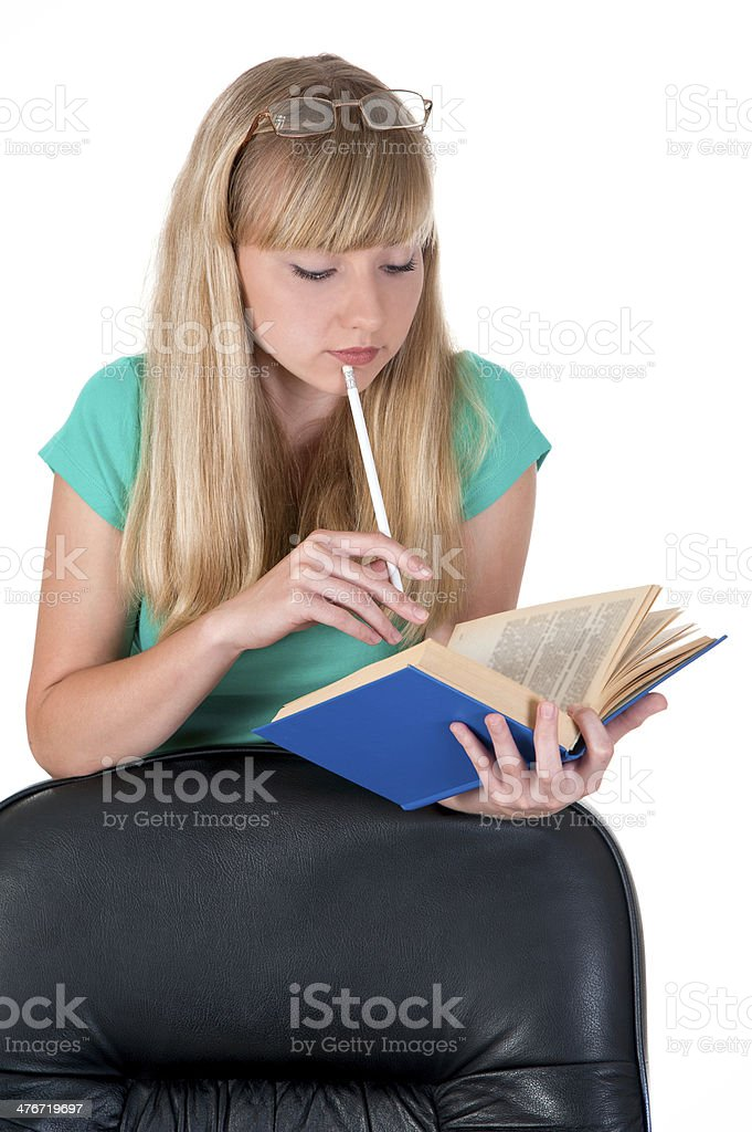 thoughtful girl with a pencil and the book of royalty-free stock photo