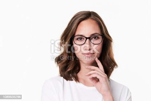 Thoughtful glasses girl on white background