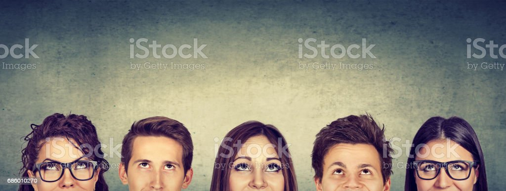 Thoughtful group of people looking up royalty-free stock photo