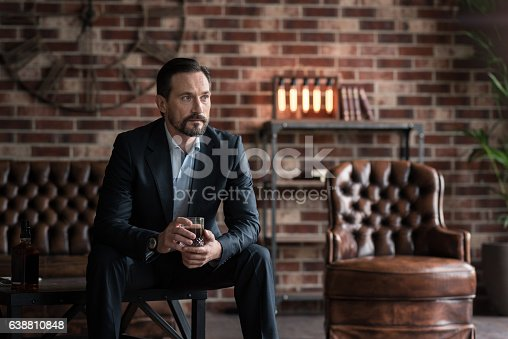istock Thoughtful handsome man drinking whisky 638810848