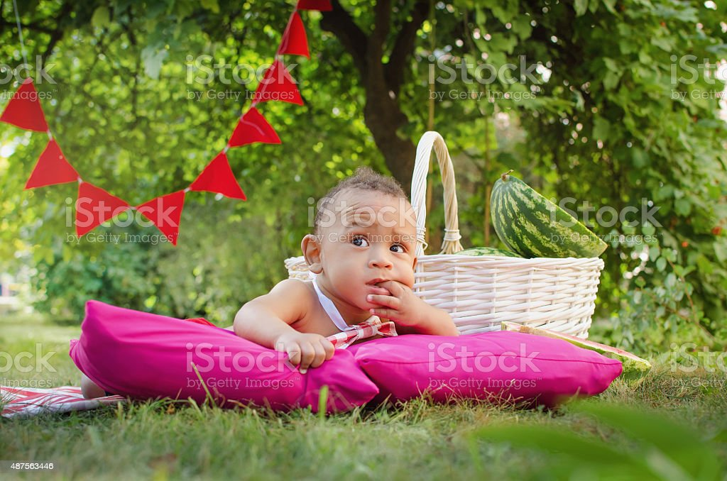 thoughtful little boy and watermelon stock photo