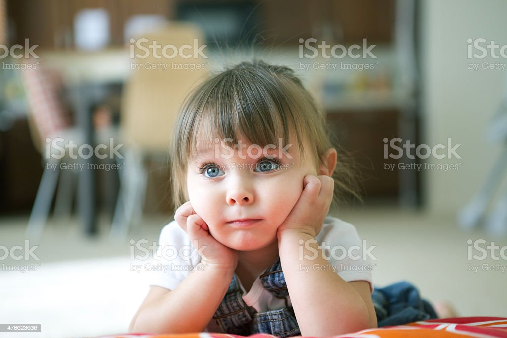 Thoughtful Little Girl Little Girl With Hands on Face 2-3 Years Stock Photo