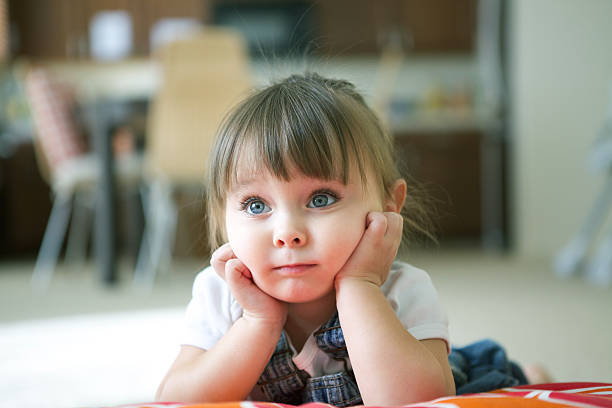 Thoughtful Little Girl Little Girl With Hands on Face 2 3 years stock pictures, royalty-free photos & images
