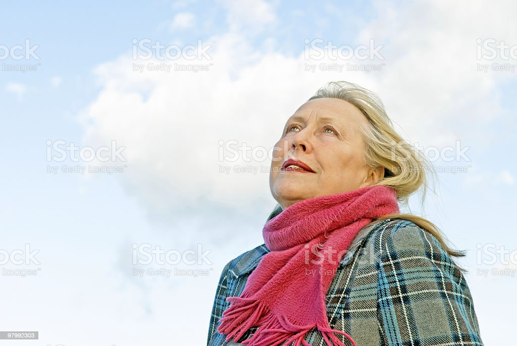 Thoughtful looking older woman royalty-free stock photo
