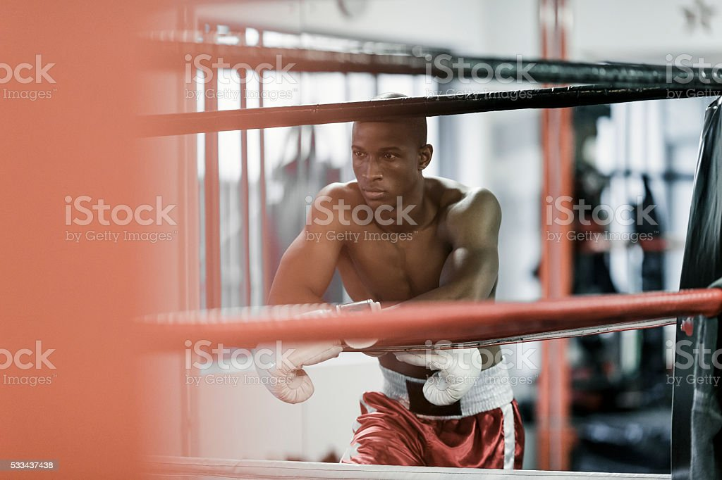 Thoughtful man leaning on boxing ring royalty-free stock photo