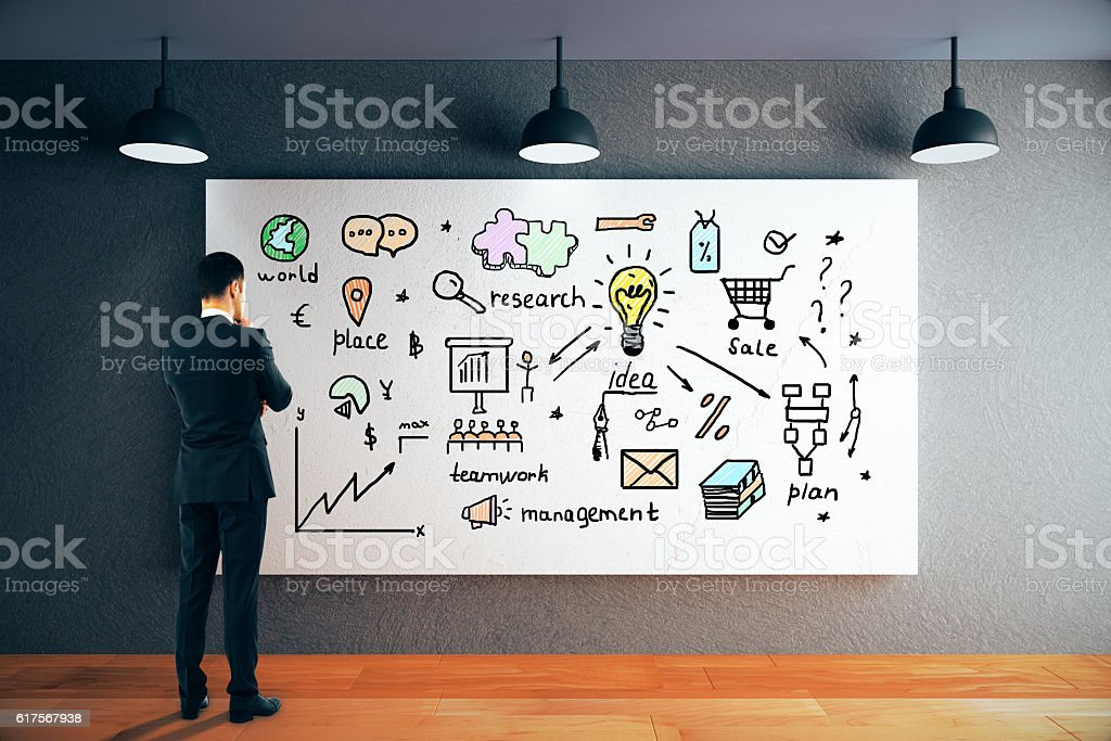 Thoughtful man looking at business sketch - foto stock