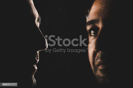 1134770826 istock photo Thoughtful man looking up through mirror 898352022