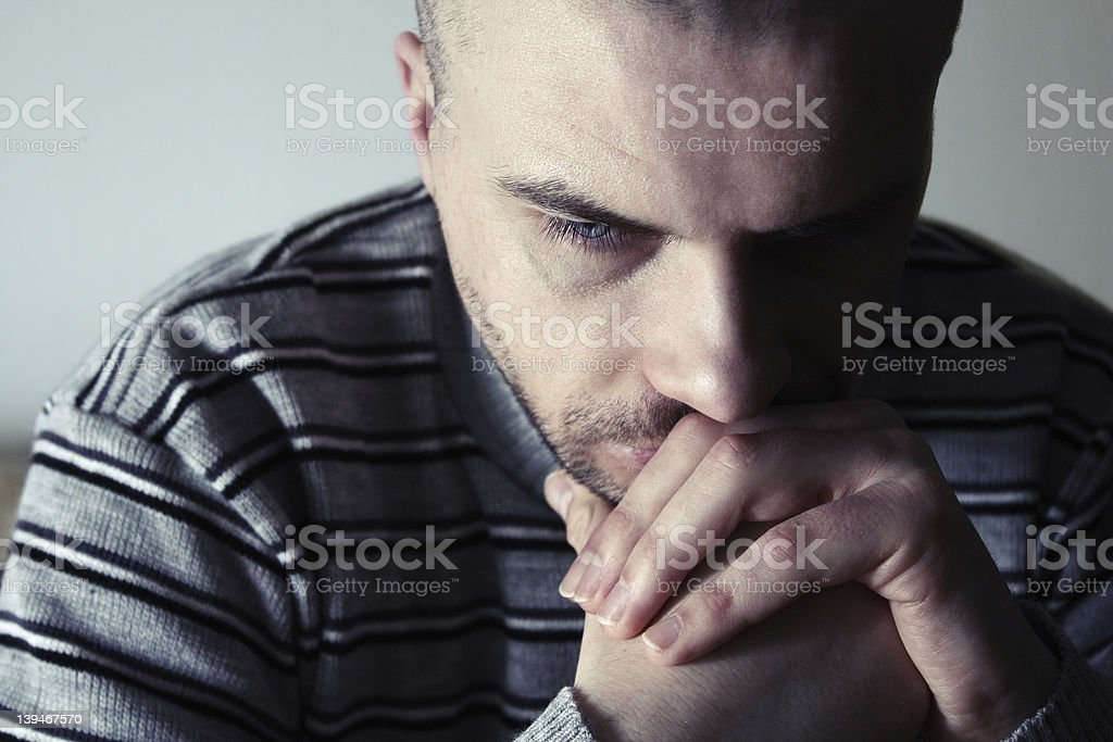 Thoughtful man stock photo