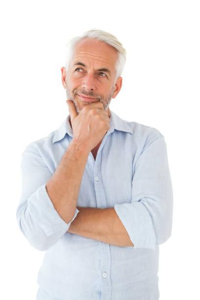 thoughtful man posing with hand on chin - mano sul mento foto e immagini stock